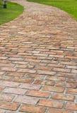 A curved brick path Stock Photos