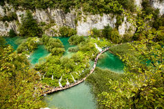 Curved bridge on a calm river, in Natural Park Plitvice Royalty Free Stock Photography