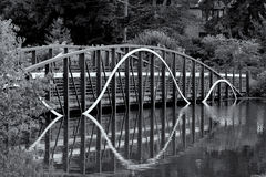 Curved Bridge Over Lake Stock Photography