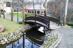 Curved bridge via the channel Royalty Free Stock Image