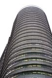 Curved building. Curved high-rise office building against white royalty free stock photography