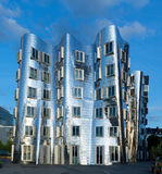Curved building in chrom at media harbour Duesseldorf Stock Photos