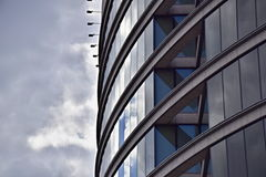 Curved Building with Glass and Steel. Architectural photograph of a curved glass skyscraper Royalty Free Stock Photo