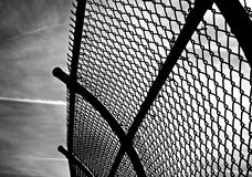 Curved chainlink fence Royalty Free Stock Image