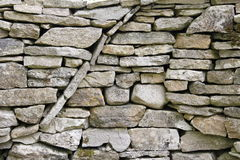 Curved circular texture pattern in a dry stone wall Stock Photos