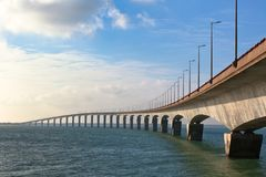 Curved Concrete Bridge. Over the water. Horizontal shot Stock Photography