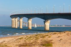 Curved Concrete Bridge over the water. Horizontal shot Royalty Free Stock Image