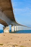 Curved Concrete Bridge over the water. Vertical shot Stock Photography