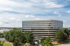 Curved Concrete Building Among Trees royalty free stock image