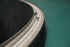 Curved concrete dam Stock Photo