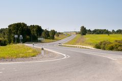 Curved country asphalt road Stock Photography