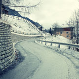 Curved country road in winter Alps Royalty Free Stock Images