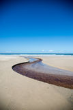 Curved creek along beach Royalty Free Stock Photo