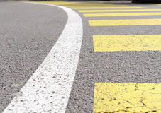 Curved crosswalk, zebra pedestrian crossing with white barrier line on asphalt Royalty Free Stock Photos