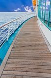Curved Deck on Ship. Old Planks on a Curved Deck on Ship between windows and railing royalty free stock image