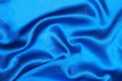 curved design on blue silk for pattern and background Stock Photo