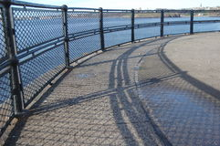 Curved fence and shadow Royalty Free Stock Images