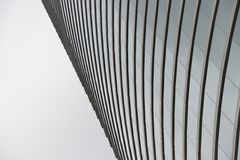Curved glass facade of Hong Kong skyscraper Royalty Free Stock Image
