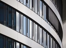 Curved glass facade of modern building stock photo