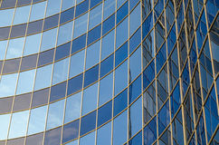 Curved glass facade of modern building Stock Photos