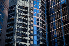 Curved Glass Skyscraper Reflections Stock Image