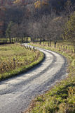 Curved gravel road in countryside Royalty Free Stock Images