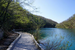 Curved gravel walkway in Plitvice national park Royalty Free Stock Photo