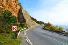 Curved highway in mountains Stock Photo