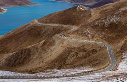 Curved road on the mountain alongside Yamdrok Lake Stock Images