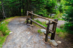 Curved hiling trail, fence. Hiking trail in highland in summer day Royalty Free Stock Image