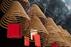Curved incense. A row of alight curved incenses Royalty Free Stock Image
