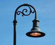 Curved lamp post royalty free stock images