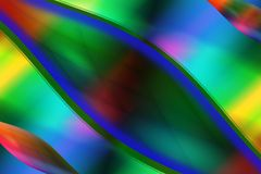 Curved lines and multiple colors. Curved lines on a background that is composed of the colors of the rainbow. The optimal blend of warm and cool colors is the royalty free illustration