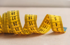 Curved measuring tape. Closeup view of yellow measuring tape. Royalty Free Stock Photos
