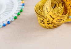 Curved measuring tape with copyspace. Closeup view of yellow measuring tape. Stock Photo