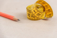 Curved measuring tape with copyspace. Closeup view of yellow measuring tape. Stock Photography