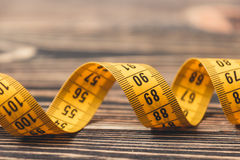 Curved measuring tape. Stock Photo