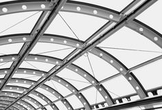 Curved metal architectural roof from a futuristic building New York, March 2017. Black and white curved metal architectural windows from a futuristic building Stock Photos