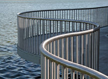 Curved metal railing Stock Images