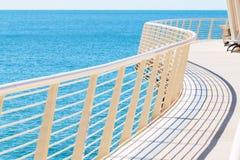 Curved metal railing of Lido di Camaiore's pier Stock Photos
