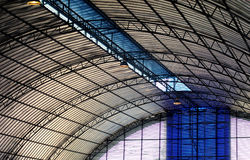 Under a metallic curved roof Stock Images