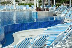 Curved modern stylish swimming pool Stock Photos