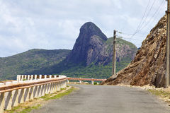 Curved Mountain Road. Mountain road with scenic tropical background Stock Image