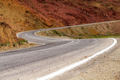 Curved mountain road rocks Royalty Free Stock Images