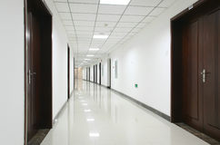 Curved office hallway. Curved interior hallway in an office building Stock Photography