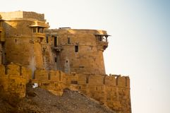 Curved outer walls windows and balconies of an indian fort. Curved outer walls, windows and balconies of the famed sonar quila or golden fort in Jaisalmer india Royalty Free Stock Photo