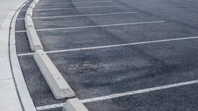 Curved parking spaces and curbs. Curved empty parking spaces and concrete curbs Royalty Free Stock Photo
