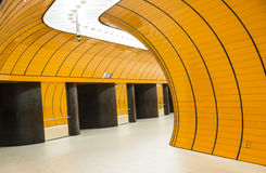 Curved passage. Curved yellow underground passage with bright neon lights Stock Photography
