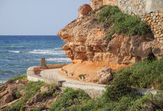 Curved path along coastal pathway. By the Mediterranean, La Zenia, Costa Blanca, Spain Royalty Free Stock Photography