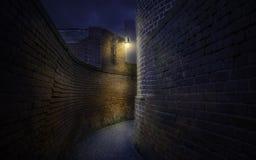 Free Curved Pathway Among Old Brick Walls At Night Royalty Free Stock Photos - 104701488